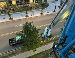Using a boom lift to clean high commercial windows